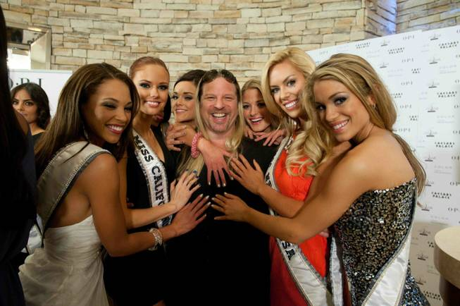 Michael Boychuck with 2011 Miss USA Pageant contestants, including Miss California Alyssa Campanella to his right and Miss Nevada Sarah Chapman to his left.