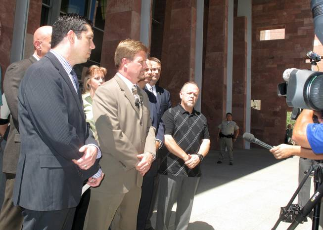 The Las Vegas Police Protective Association filed legal petitions Tuesday in Clark County District Court to block changes to the coroner's inquest process, alleging the changes are unconstitutional. The police union's executive director, Chris Collins (front and center), addresses the media Tuesday morning.