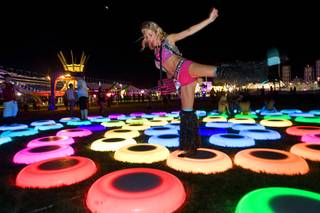 Dina Bronshteyn,31, of Orlando, Fla. jumps on lighted rings during the Electric Daisy Carnival at the Las Vegas Motor Speedway June 24, 2011.