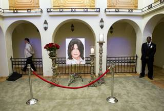 A photo of Michael Jackson is displayed at a home where the entertainer used to live on Palomino Lane Saturday, June 25, 2011. The homeowner opened a portion of the home to the public to mark the second anniversary of the entertainer's death.