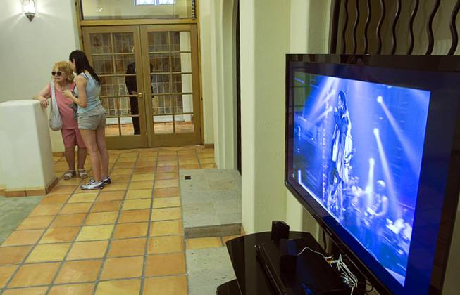 A video featuring Michael Jackson plays at a home where the entertainer used to live on Palomino Lane June 25, 2011. The homeowner opened a portion of the home to the public to mark the second anniversary of the entertainer's death.