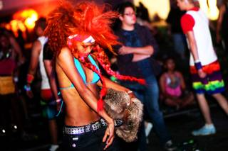 Margo dances to he music during the Electric Daisy Carnival at the Las Vegas Motor Speedway Sunday, June 25, 2011.