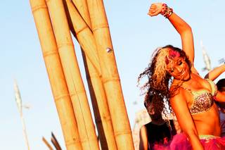 Taylor Bellinghausen keeps dancing as the sun rises during the Electric Daisy Carnival at the Las Vegas Motor Speedway Sunday, June 26, 2011.