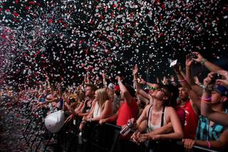 Confetti falls on the audience as Swedish House Mafia  begins their set at the Electric Daisy Carnival at the Las Vegas Motor Speedway Sunday June 26, 2011.