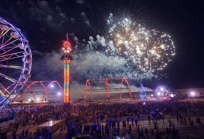 Fireworks explode over the Electric Daisy Carnival at the Las Vegas Motor Speedway Sunday June 26, 2011.