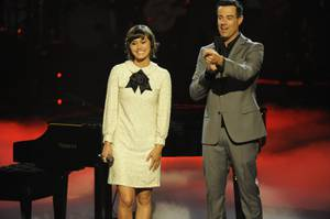 Dia Frampton appears on the NBC talent show <em>The Voice</em> with host Carson Daly.