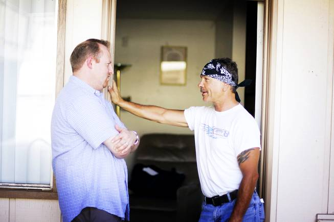Jeff Iverson, left, talks with Daniel Moore, an outreach coordinator at Freedom House Sober Living apartments in Las Vegas Wednesday, June 29, 2011.