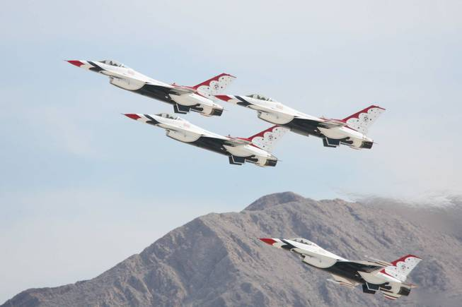 F-16 jets from the U.S. Air Force Air Demonstration Squadron Thunderbirds perform during their annual show at Nellis Air Force Base in 2009. Nellis officials on Thursday confirmed that an F-16 pilot died in a Tuesday crash near Caliente.