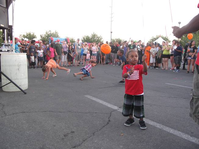 Children dance while a DJ plays songs for the younger crowds at North Las Vegas' Independence Day Jubilee Saturday night. The city's annual event featured live music, food and fireworks and was expected to draw about 40,000 people.