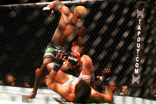 Melvin Guillard winds up to hit Shane Roller in their lightweight bout at UFC 132 Saturday, July 2, 2011, at the MGM Grand Garden Arena in Las Vegas. Guillard won by knockout in the second round.