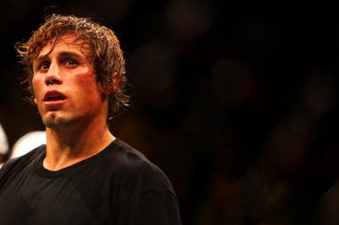 Urijah Faber looks away as the decision is announced after the main event bout at UFC 132 against Dominick Cruz during UFC 132 Saturday at the MGM Grand Garden Arena.  Cruz won by unanimous decision.