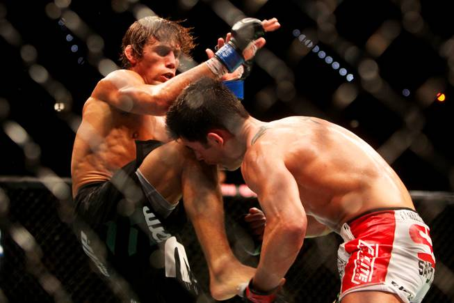 Dominick Cruz catches Urijah Faber's foot during their main event bout at UFC 132 Saturday at the MGM Grand Garden Arena.  Cruz won by unanimous decision.