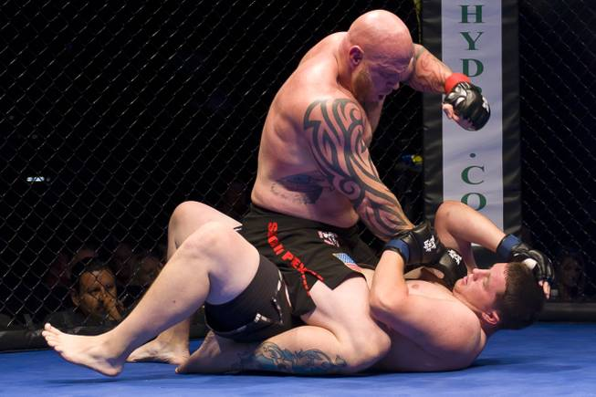 Carl Postma makes short work of Brandon Browning to earn the inaugural Tuff-N-Uff Randy Couture Heavyweight Belt at The Cox Pavilion July 1, 2011.