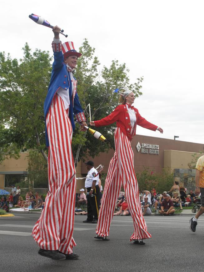Two patriotic stilt walkers entertain crowds along the parade route Monday at Summerlin's 17th annual Patriotic Parade.