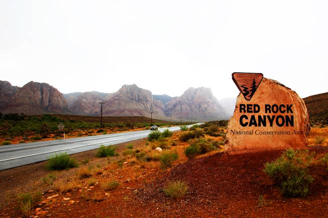 Heavy rain created flooding seen along State Road 159 in the Red Rock Canyon area on Tuesday, July 5, 2011.