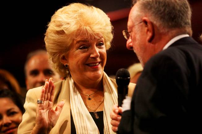 Oscar Goodman swears in his wife, Carolyn Goodman, as the new Mayor of Las Vegas during the City Council meeting Wednesday, July 6, 2011.