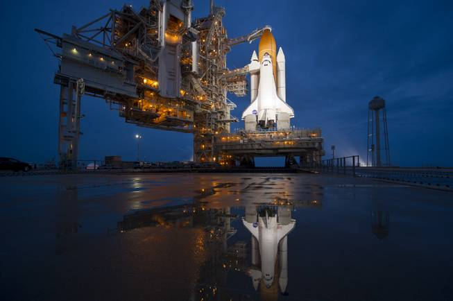 In this image provided by NASA the space shuttle Atlantis is seen shortly after the rotating service structure (RSS) was rolled back at launch pad 39a, Thursday, July 7, 2011 at the NASA Kennedy Space Center in Cape Canaveral, Fla.