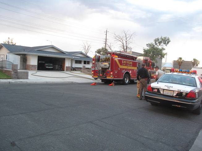 The Las Vegas Fire Department and Metro police respond to the scene of a house fire near Rainbow Boulevard and Westcliff Drive where one woman was found dead.