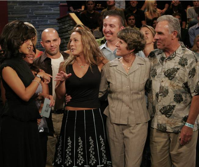 "In this photo provided by CBS, Maggie Ausburn, third from left, speaks to fellow contestants and family memebers after she was declared the winner of the CBS show ""Big Brother 6"" Tuesday, Sept. 20, 2005, in Los Angeles. She is speaking with, from left, show host Julie Chen, fellow houseguest Eric Littman, her boyfriend Dave Bray, mother Ann, and father Ron."