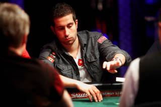 Last years winner, Jonathan Duhamel, folds his hand during Day 1C of the World Series of Poker main event at the Rio Las Vegas Saturday, July 9, 2011. To accommodate all the entries, there are four
