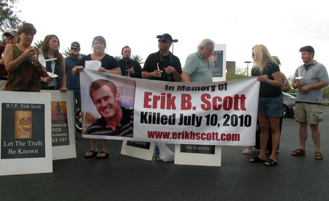 Friends and supporters mark the one-year anniversary of Erik Scott's death outside the Summerlin Costco, where he was fatally shot by Metro Police officers.