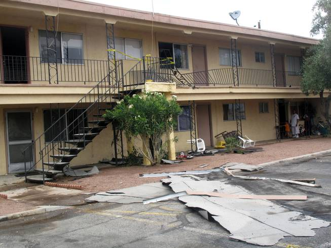 Heavy rain and strong winds tore a roof off a building in the Willow Gardens Apartments on Vegas Drive. The storm also slammed a metal railing into a second-floor unit, leaving a 2-year-old boy with minor injuries.