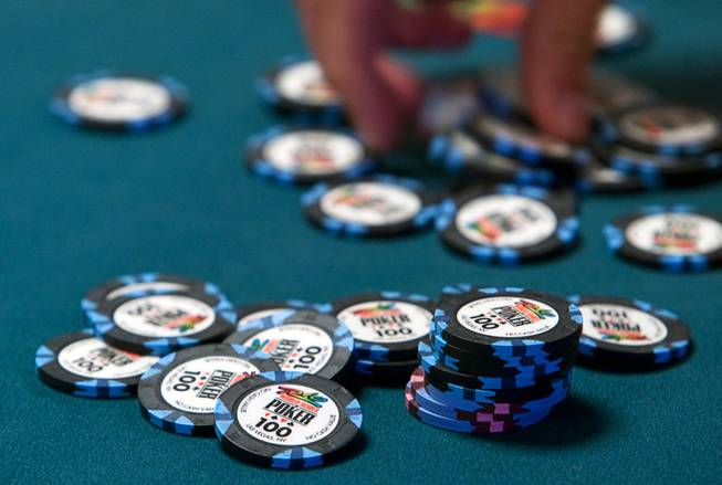 A player stacks chips after winning a hand during the World Series of Poker main event at the Rio Monday, July 11, 2011.