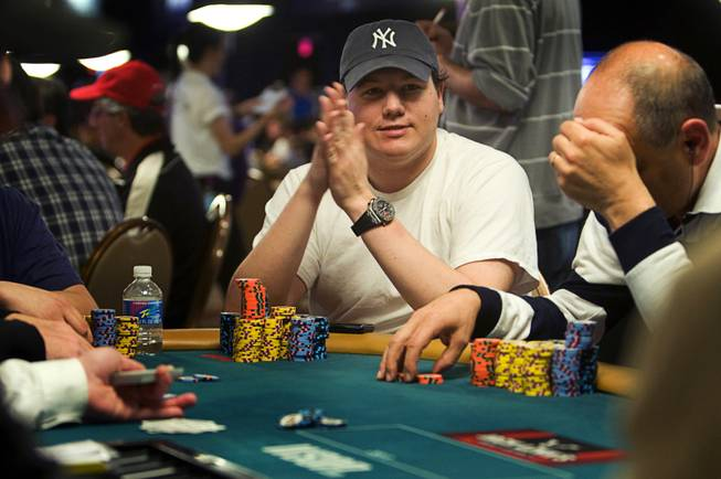Poker professional Shaun Deeb competes during the World Series of Poker main event at the Rio Monday, July 11, 2011.