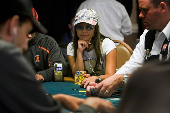 Poker player Lisa Hamilton competes during the World Series of Poker main event at the Rio Monday, July 11, 2011.