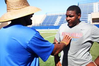 Bishop Gorman High School lineman, and UNLV recruit, Ron Scoggins, gets instructions from his coach during practice Tuesday, July 12, 2011.