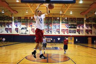Coronado high school senior basketball player Michael Louder dunks during practice Wednesday, July 13, 2011.
