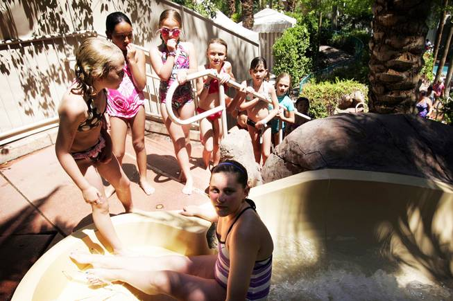 Kids line up to go down the waterslide at the Flamingo Beach Club Pool in Las Vegas Thursday, July 14, 2011.