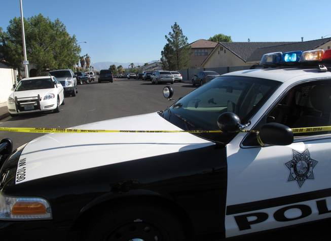Metro Police investigate after officers fatally shot 23-year-old Rafael Alonso Olivas on July 14, 2011, in the western Las Vegas Valley.