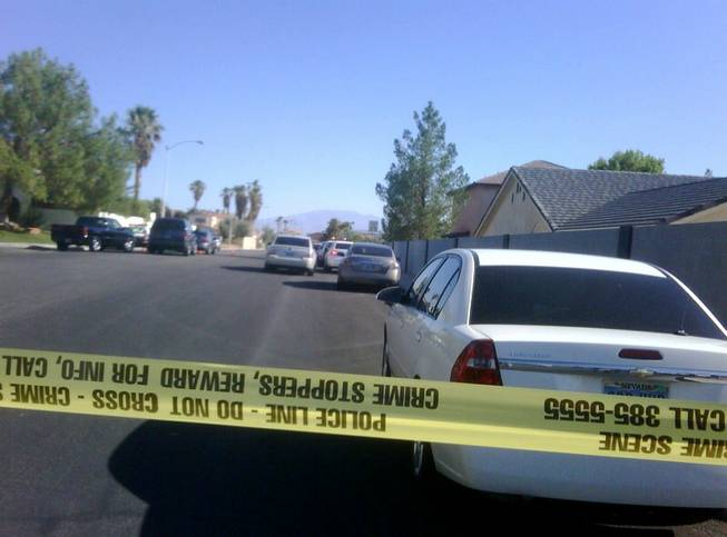 Metro Police investigate an officer-involved shooting Thursday morning in the western Las Vegas Valley.