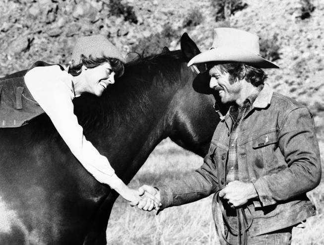 "In this photo provided by Columbia Pictures, ex-rodeo star Robert Redford gives TV newscaster Jane Fonda her first riding lesson, aboard a stolen million-dollar stallion in the Columbia Pictures release, ""The Electric Horseman,"" December 1979."