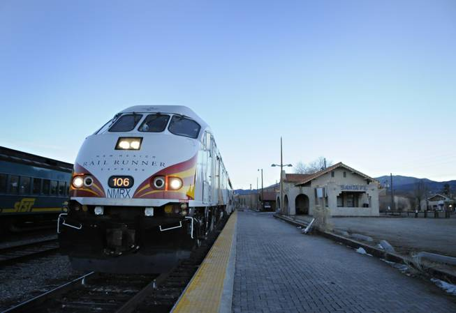 The locomotive of the south-bound 106 Rail Runner is seen as it waits to depart from Santa Fe, N.M. Wednesday, Jan. 14, 2009.