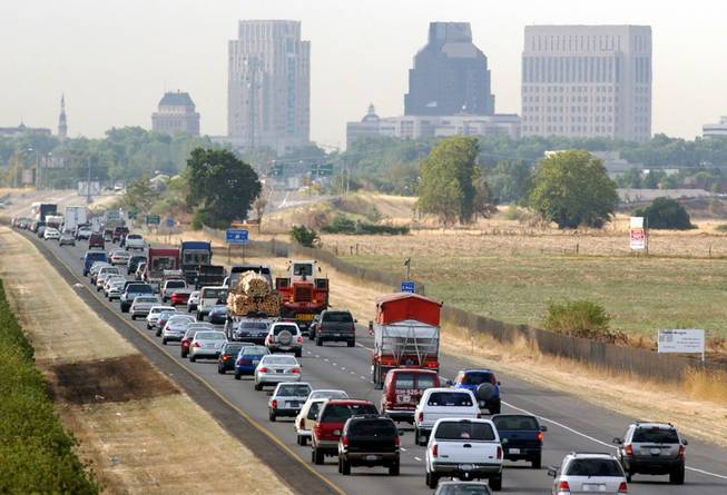 Motorists head south on Interstate 5 toward downtown Sacramento, Calif., during the morning rush hour Friday, July 12, 2002.