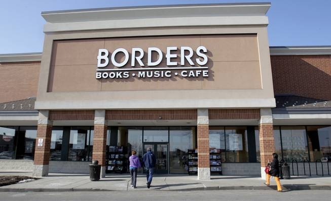 Customers walk into a Borders Books & Music store, in Ann Arbor, Mich. Borders Group filed for bankruptcy Monday, July 18, 2011, after seeking court approval to liquidate its 399 stores when the company failed to receive any bids that would keep the 40-year-old chain in operation.
