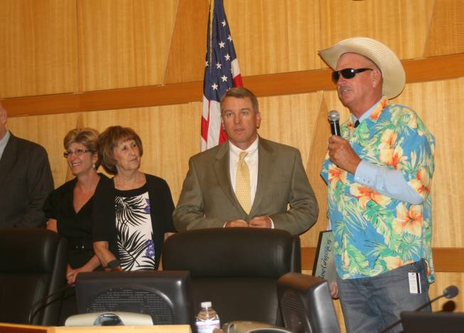 County Commissioner Tom Collins dresses for the occasion while giving a proclamation to the Las Vegas Motor Speedway over the success of the Electric Daisy Carnival.