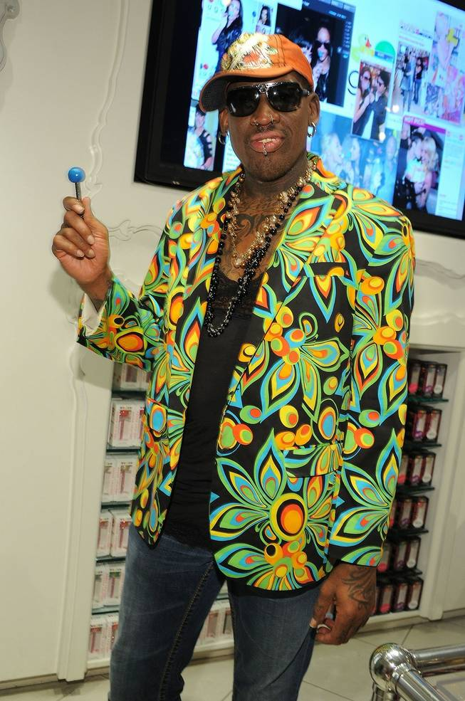 Dennis Rodman with a Couture Pop at Sugar Factory in the Paris on July 19, 2011.