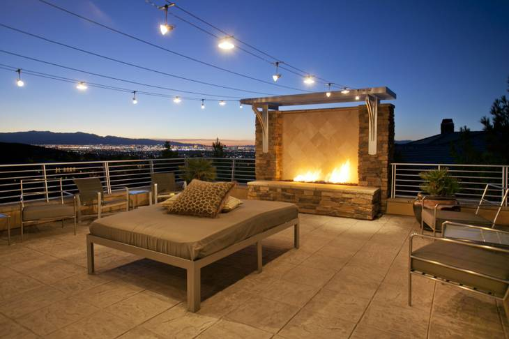 The residence at 641 Saint Croix St., Henderson, features a deck with an outdoor fireplace and a view of the Las Vegas Strip. It sold for $3.2 million in October 2012.