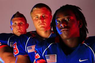 Bishop Gorman High School football players Nick Strehlow, Ben Guida and Jelani Walls.
