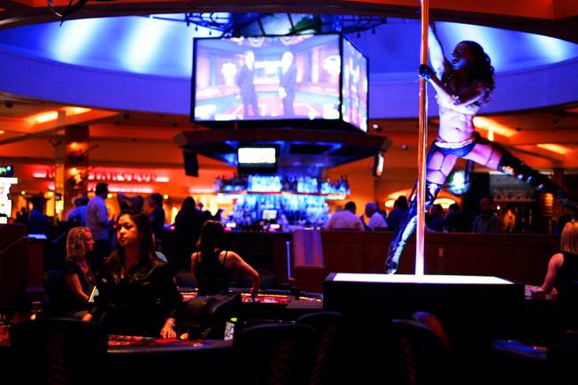 Dancer Doneshia Crowder dances inside the Hells Belles Party Pit inside of the Hard Rock Hotel and Casino in Las Vegas Thursday, July 21, 2011.