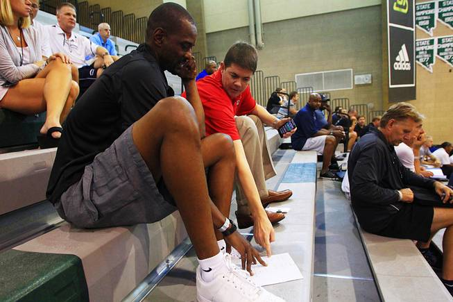 UNLV coaches Stacey Augmon and Dave Rice evaluate players on Friday, July 22, 2011 during the adidas Super 64 tournament at Rancho High School.