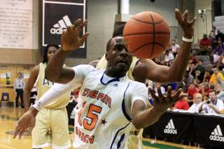 Dream Vision's Shabazz Muhammad reaches for a loose ball while taking on the Atlanta Celtics Friday, July 22, 2011 during the adidas Super 64 tournament.
