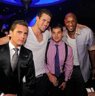 Scott Disick, Kris Humphries, Robert Kardashian Jr. and Lamar Odom attend Humphries' bachelor party at Lavo in the Palazzo on July 23, 2011.