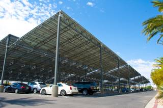 Giant solar panels structured over the parking area provide the energy needed to manufacture the products at ProCaps Laboratories, Monday July 25th, 2011.