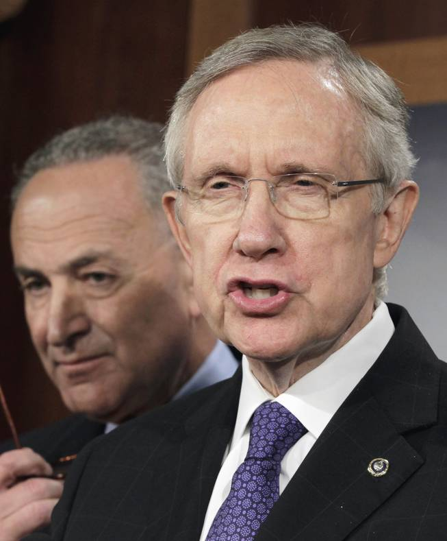 Senate Majority leader Harry Reid of Nev., right, accompanied by Sen. Charles Schumer, D-NY, speaks to reporters on Capitol Hill in Washington, Monday, July 25, 2011, as they announce a new proposal to solve the debt limit crisis.