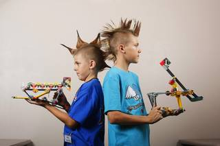 Brothers Riley, 9, and Brendan Mulcahy, 13 pose with their K*bots during the K*bot World Championships at the Veterans Memorial Leisure Services Center in Summerlin Thursday, July 26, 2011. The K*bots are created using K'Nex Construction kits.