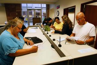 People fill out paperwork at the Civil Law Self Help Center in the Regional Justice Center Thursday, July 28, 2011.